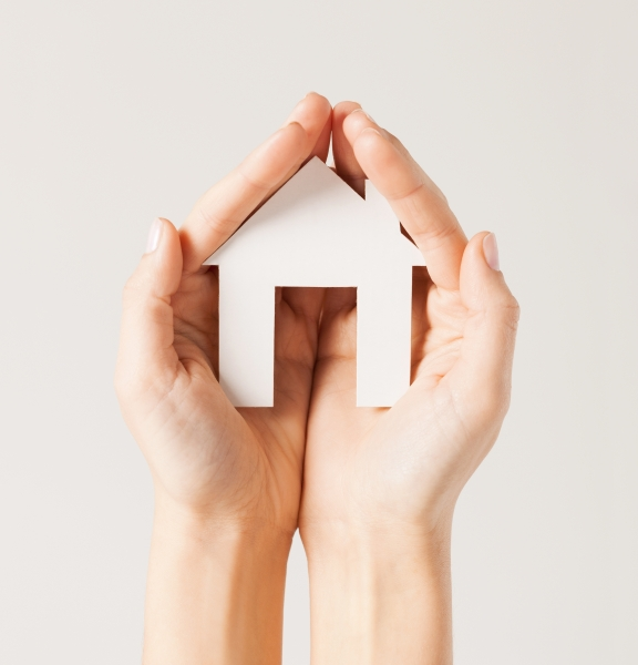 5144078-woman-hands-with-paper-house