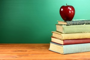 5404026-back-to-school-books-and-apple-with-chalkboard (1)