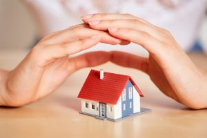 Hands,Protect,House,As,Insurance,Or,House,Purchase,Concept